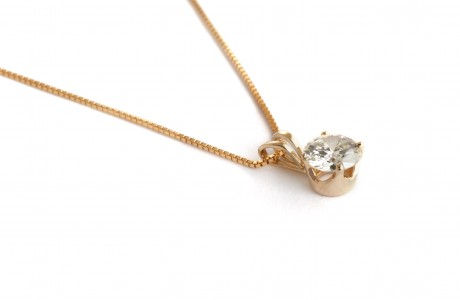 Golden chain with diamond pendant