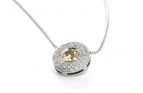 Round golden pendant set with diamonds and a precious stone